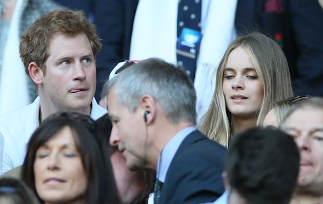 Britain's Prince Harry with his girlfriend Cressida Bonas attend the Six Nations Rugby Union match between England and Wales at Twickenham stadium in London Sunday March, 9, 2014. (AP Photo/Alasta