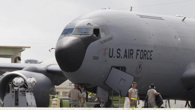 In this Aug. 14, 2012 photo, ground crew members work on a U.S. Air Force KC-135 Stratotanker at Kadena Air Base on Japan's southwestern island of Okinawa. The most recent of the KC-135 refueling tankers currently in service started flying in 1964. For decades, the U.S. Air Force has grown accustomed to such superlatives as unrivaled and unbeatable. Now some of its key aircraft are being described with terms like decrepit.  (AP Photo/Greg Baker)