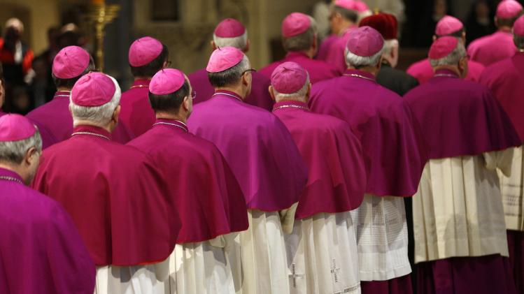 Bishops arrive for the opening mass of the annual German Bishops' Conference in a cathedral in Muenster