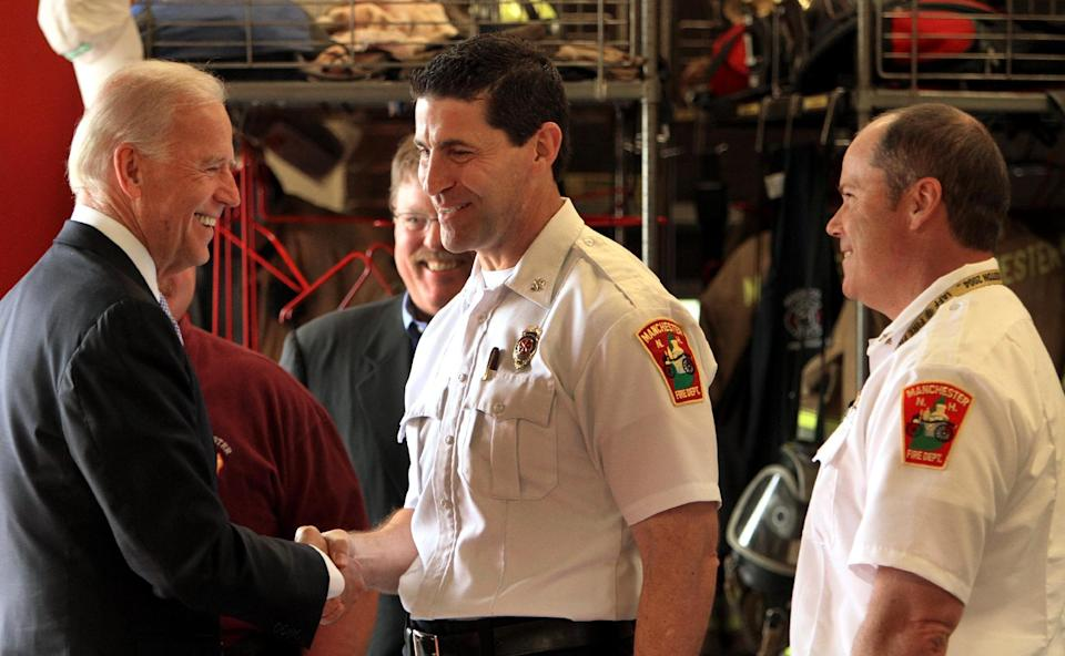 Vice President Joe Biden greets firefighters at the fire department station in Manchester, N.H., Tuesday, May 22, 2012.  (AP Photo/Jim Cole)