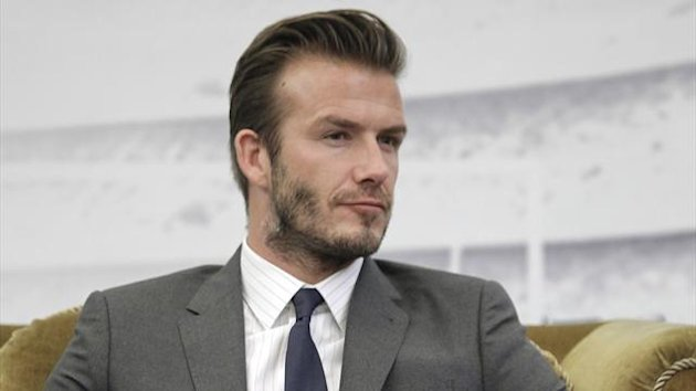 Former England captain David Beckham addresses a news conference in Shanghai June 20, 2013 (Reuters)
