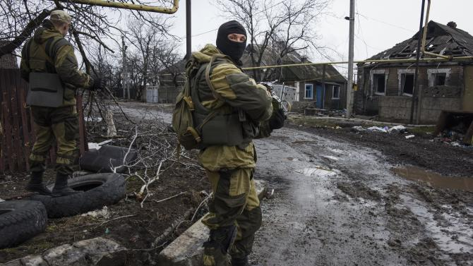 Russia-backed rebels take positions on the outskirts of Donetsk, eastern Ukraine, Thursday, April 2, 2015. OSCE monitors accompanied by pro-Russian rebels visited the ruins of Donetsk Airport and nearby areas to monitor the situation on the ground and discuss the observance of February's cease-fire. (AP Photo/Mstyslav Chernov)