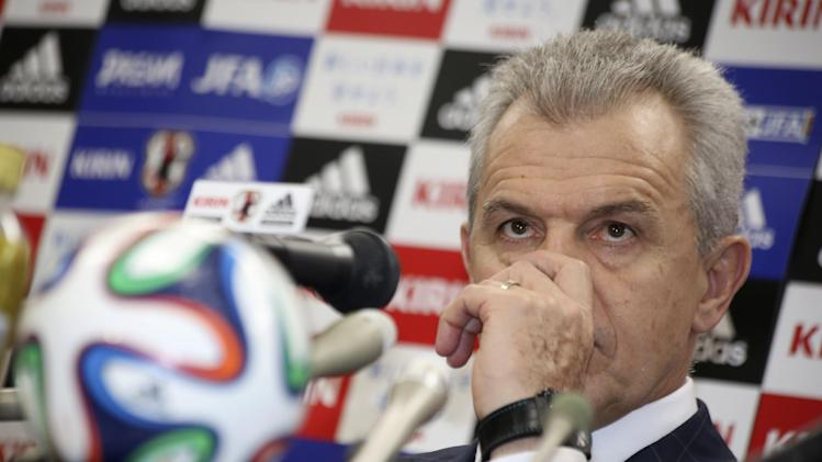 Japan's national soccer team coach Javier Aguirre listens to questions during a press conference to unveil a new squad list for Japan's upcoming friendly matches against Uruguay and Venezuela, in Tokyo Thursday, Aug. 28, 2014. (AP Photo/Eugene Hoshiko)