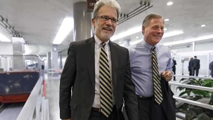 FILE - In this Dec. 19, 2013 file photo, Sen. Tom Coburn, R-Okla., left, walks with Sen. Richard Burr, R-N.C., on the way to a procedural vote on a comprehensive defense bill as the Senate's legislative year nears to a close, at the Capitol in Washington. Coburn's announcement late last week that he will forego his final two years in office means Oklahoma will not only have two US Senate races this year, it is expected to trigger a series of dominoes on the GOP side as politicians on the Sooner State's deep Republican bench mull a run. (AP Photo/J. Scott Applewhite, File)