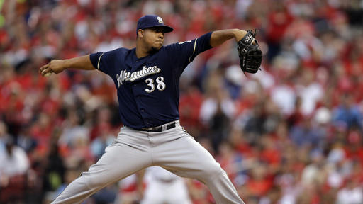 Peralta wins 13th, Brewers beat Cardinals 7-4