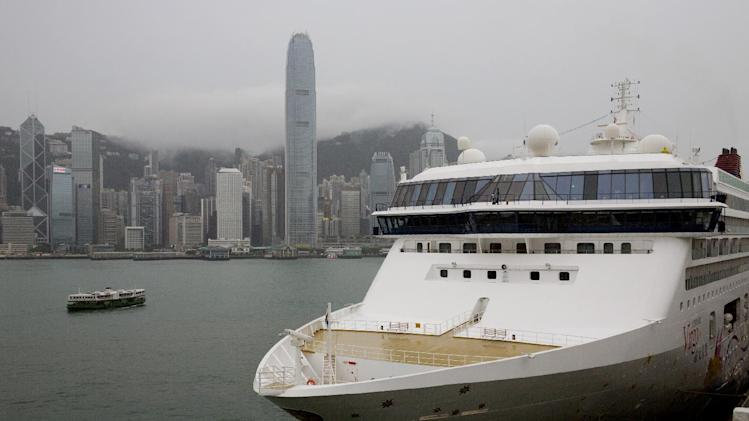 In this Wednesday, Aug. 13, 2014 photo, Star Cruises cruise ship Superstar Virgo is docked at Ocean Terminal in Hong Kong. Hong Kong christened a new $1.2 billion cruise terminal in 2013, but the Norman Foster-designed facility has so far been infrequently used, though visits are expected to pick up in coming years. Visitors have criticized the terminal, built at the end of the old Kai Tak airport's runway jutting into the scenic harbor, for being hard to access by bus or taxi. A smaller terminal near the city center is more popular and a home base for ships operated by Genting Group's Star Cruises. (AP Photo/Vincent Yu)