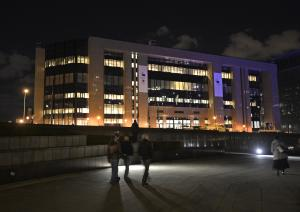 The EU council building is illuminated late in the…