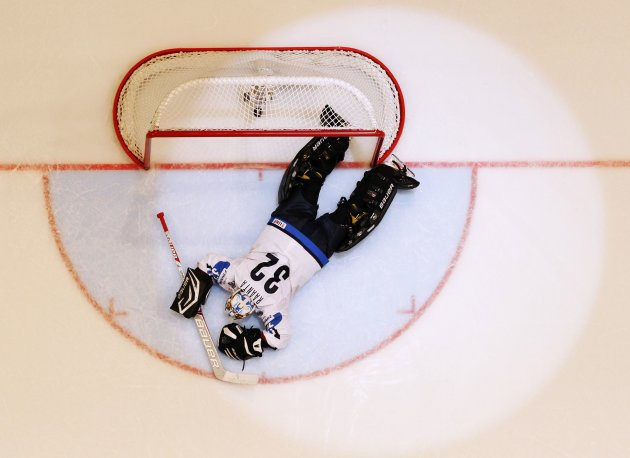 Finland's Raanta reacts after conceeding the match winning goal to Team USA's Galchenyuk during their 2013 IIHF Ice Hockey World Championship bronze medal match at the Globe Arena in Stockholm