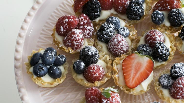 In this image taken on March 4, 2013, creamy lemon-berry tartlets are shown served on a dessert stand in Concord, N.H. (AP Photo/Matthew Mead)