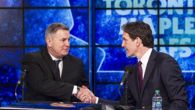 Tim Leiweke, left, president and CEO of Maple Leaf Sports and Entertainment, shakes hands with new Toronto Maple Leafs president Brendan Shanahan following a news conference in Toronto on Monday, April 14, 2014. Shanahan, a Hockey Hall of Famer, says he's eager to get to work learning about the organization, which missed the playoffs after a late-season collapse