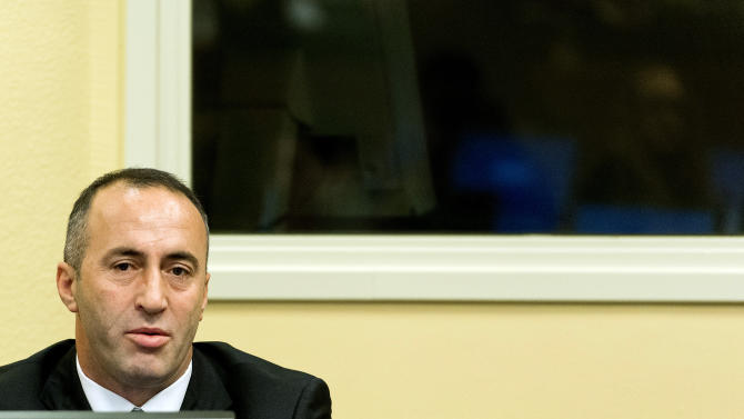 Former Kosovo Prime Minister Ramush Haradinaj awaits his verdict at the courtroom of the Yugoslav war crimes tribunal in The Hague, Netherlands, Thursday, Nov. 29, 2012. The Yugoslav war crimes tribunal will deliver its verdicts Thursday in the unprecedented retrial of Kosovo's ex-prime minister and two of his former Kosovo Liberation Army comrades on charges including the murder and torture of Serbs. The U.N. court's first ever retrial was ordered following the 2008 acquittal of former Prime Minister Ramush Haradinaj and KLA fighter Idriz Balaj and the conviction of a third KLA commander, Lahi Brahimaj. Haradinaj, Balaj and Brahimaj are accused of abusing Serbs or their supporters in 1998 as Kosovo battled for independence from Serbia, which it eventually declared in 2008. (AP Photo/ Koen van Weel, Pool)