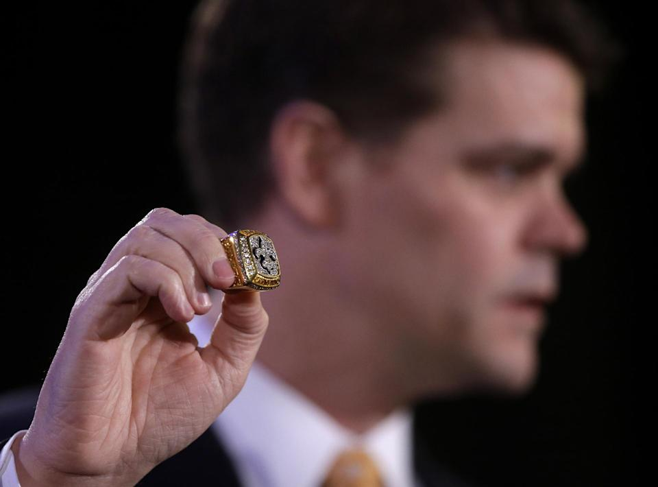 John Morton, U.S. Immigration and Customs Enforcement Director, holds up a confiscated counterfeit New Orleans Saints Super Bowl ring, at a news conference regarding NFL counterfeit Super Bowl merchandise and tickets for the upcoming Super Bowl XLVII, in New Orleans, Thursday, Jan. 31, 2013. (AP Photo/Gerald Herbert)
