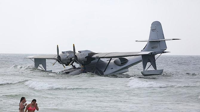 "In this June 30, 2015 photo, a vintage PBY-6A flying boat rests on the sandy bottom of the Gulf of Mexico, just off the shore near Orange Beach, Ala. The aircraft took on water and became stranded while it was being used in the filming of the Nicolas Cage movie ""USS Indianapolis: Men of Courage."" (Brian Kelly/Al.com via AP)"