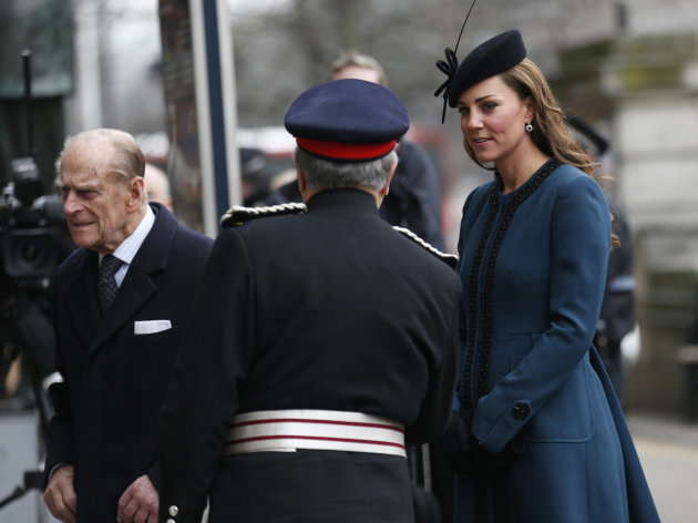 Britain&#39;s Kate, Duchess of Cambridge, right, accompanies Queen Elizabeth II, unseen, and Prince Philip, left, at Baker Street underground station in London for a visit to mark the 150th anniversary of the London Underground, Wednesday, March 20, 2013. (AP Photo/Sang Tan)