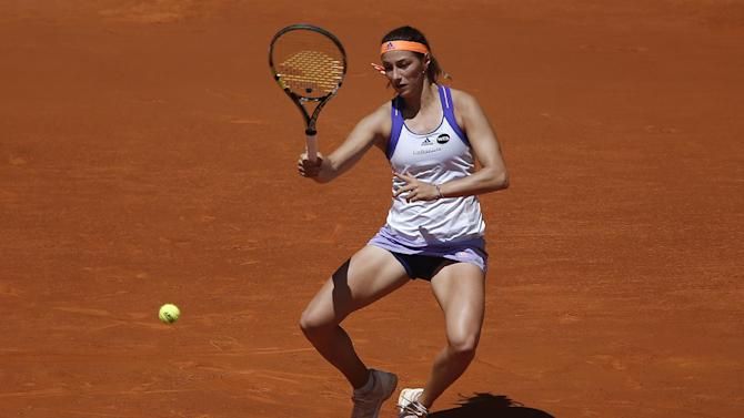 Mariana Duque Marino from Colombia returns the ball during the Madrid Open tennis tournament match against Maria Sharapova from Russia in Madrid, Spain, Tuesday, May 5, 2015. (AP Photo/Andres Kudacki)