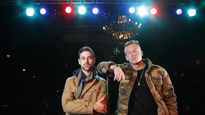 """FILE - In this Nov. 20, 2012 file photo, American musician Ben Haggerty, better known by his stage name Macklemore (R), and his producer Ryan Lewis pose for a portrait at Irving Plaza in New York.  Macklemore & Ryan Lewis feat. Wanz, """"Thrift Shop"""" (Macklemore) is the number one top streamed track for the United States on Spotify from Monday, Jan. 21, to Sunday, Jan. 27, 2013. (Photo by Carlo Allegri/Invision/AP, File)"""
