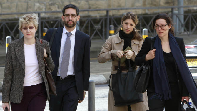 """FILE - Negotiators from Cyprus' potential creditors, from left to right Mary McCarthy, Matteo Duiella, Daphne Momferatou and Datka Funke walk toward the Cypriot Finance Ministry in capital Nicosia, in this Friday, Nov 9, 2012 file photo. The creditors said Friday Nov 23 2012 they have made """"good progress"""" in negotiations on a possible bailout for the crisis-hit country. Despite earlier hopes that a deal was imminent, they said long-distance talks would continue on securing an agreement that will make Cyprus the fourth euro country to receive international help with its debts. (AP Photo/Petros Karadjias, File)"""