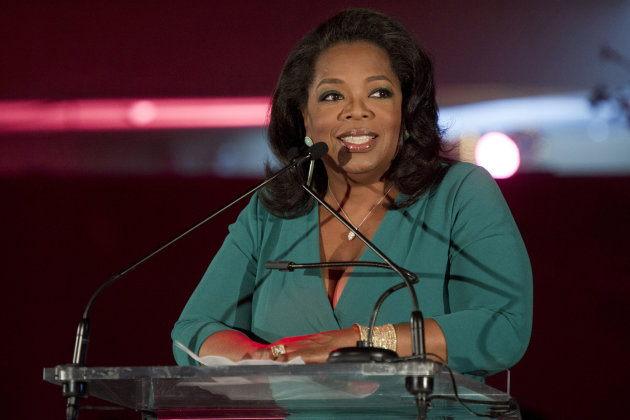 "FILE - In this March 9, 2012 file photo, Oprah Winfrey accepts her DVF Lifetime Leadership Award at The Third Annual DVF Awards held at the United Nations in New York. ""Oprah's Book Club 2.0,"" a joint project of Winfrey's OWN network and her ""O"" magazine, begins Monday with Cheryl Strayed's popular memoir ""Wild."" Along with the traditional paper version of the book, special e-editions will be made available that include Winfrey's comments and a reader's guide. (AP Photo/Charles Sykes, File)"