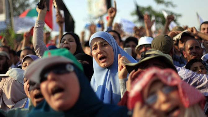 "Supporters of Egypt's president Mohammed Morsi chant slogans during a rally in Nasser City in Cairo, Egypt, Friday, June 21, 2013. Tens of thousands of Islamists supporting Egypt's president staged a show of force ahead of massive protests later this month by the opposition, chanting ""Islamic revolution"" and warning of a new and bloody bout of turmoil. Adding to the combustible mix, the U.S. ambassador in Egypt gets drawn into Egypt's treacherous politics when comments interpreted as critical of the opposition spark outrage, with one activist telling the diplomat to ""shut up and mind your own business.""(AP Photo/Khalil Hamra)"