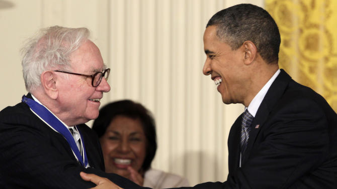 "FILE - In this Feb. 15, 2010, file photo President Barack Obama congratulates Warren Buffett after presenting him with a 2010 Presidential Medal of Freedom in an East Room ceremony at the White House in Washington. In his weekly radio and internet address Saturday April 14, 2012, Obama urged Americans to ask their member of Congress to support the ""Buffett Rule,"" named after the billionaire investor who says he pays a lower tax rate than his secretary. Obama says the nation can't afford to keep giving tax cuts to the wealthiest, ""who don't need them and didn't even ask for them."" (AP Photo/Carolyn Kaster)"