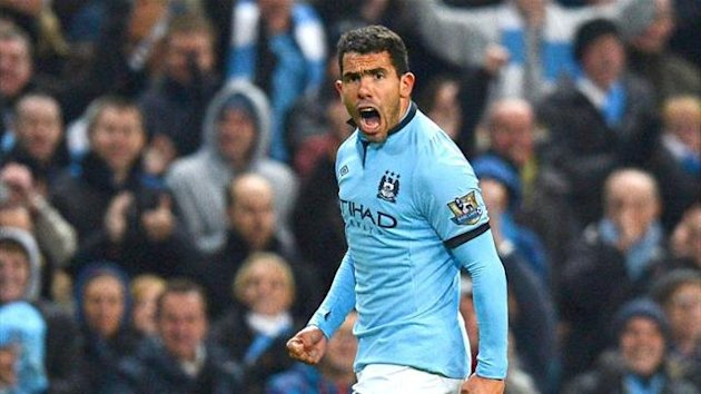 Carlos Tevez celebrates scoring for Manchester City against Swansea City, October 2012