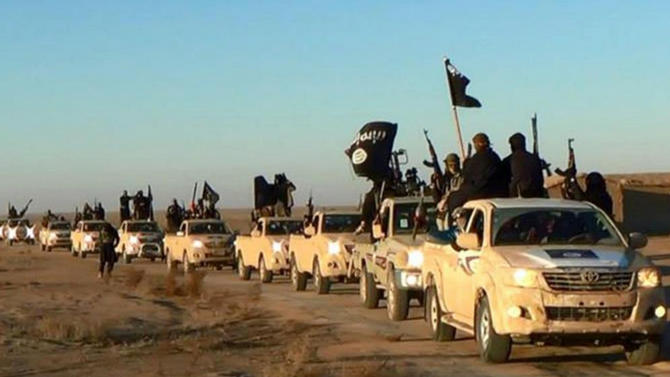 """FILE - In this undated file photo released by a militant website, which has been verified and is consistent with other AP reporting, militants of the Islamic State group hold up their weapons and wave its flags on their vehicles in a convoy on a road leading to Iraq, while riding in Raqqa city in Syria. The notion that young women are traveling to Syria solely to become """"jihadi brides"""" is simplistic and hinders efforts to prevent other girls from being radicalized, new research suggests. Young women are joining the so-called Islamic State group for many reasons, including anger over the perceived persecution of Muslims and the wish to belong to a sisterhood with similar beliefs, according to a report released Thursday, May 28, 2015, by the Institute for Strategic Dialogue and the International Center for the Study of Radicalization at King's College London. (Militant website via AP, file)"""
