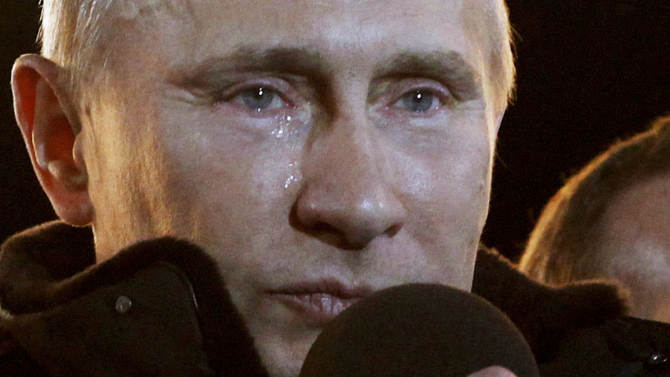 Russian Prime Minister Vladimir Putin, who claimed victory in Russia's presidential election, tears up as he reacts at a massive rally of his supporters at Manezh square outside Kremlin, in Moscow, Sunday, March 4, 2012. Vladimir Putin has claimed victory in Russia's presidential election, which the opposition and independent observers say has been marred by widespread violations. Putin made the claim at a rally of tens of thousands of his supporters just outside the Kremlin, thanking his supporters for helping foil foreign plots aimed to weaken the country. (AP Photo/Ivan Sekretarev)