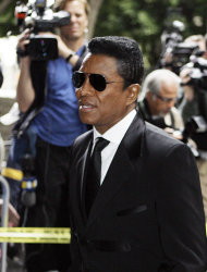 Michael Jackson's brother Jermaine arrives for the sentencing of Conrad Murray, convicted of involuntary manslaughter in the death of pop star Michael Jackson, at the Los Angeles Criminal Justice Center Tuesday, Nov. 29, 2011. (AP Photo/Reed Saxon)