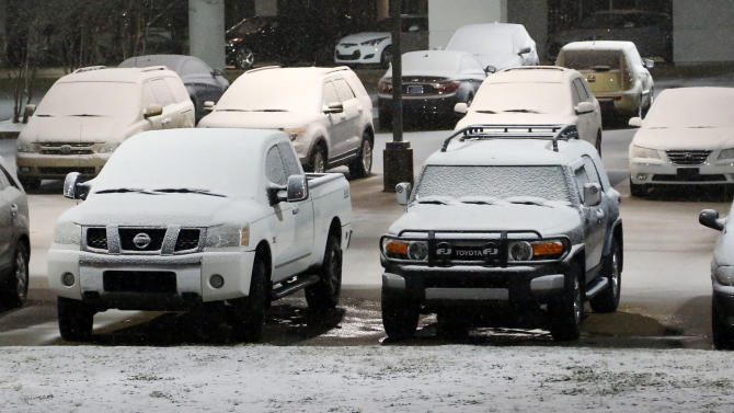 Cars in this car dealer's lot in Flowood, Miss., show the accumulation of snow early Thursday morning Jan. 17, 2013, in Flowood, Miss. The National Weather Service says central Mississippi could get from 2 to 4 inches of snow from midnight through midmorning Thursday. (AP Photo/Rogelio V. Solis)