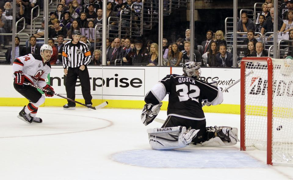New Jersey Devils center Adam Henrique (14) scores the game winning goal past Los Angeles Kings goalie Jonathan Quick (32) in the third period during Game 4 of the NHL hockey Stanley Cup finals, Wednesday, June 6, 2012, in Los Angeles.  (AP Photo/Julie Jacobson)