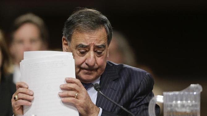 Outgoing Defense Secretary Leon Panetta adjusts his papers as he testifies on Capitol Hill in Washington, Thursday, Feb. 7, 2013, before the Senate Armed Services Committee about the Pentagon's role in responding to the attack last year on the U.S. consulate in Benghazi, Libya, where the ambassador and three other Americans were killed.  (AP Photo/J. Scott Applewhite)