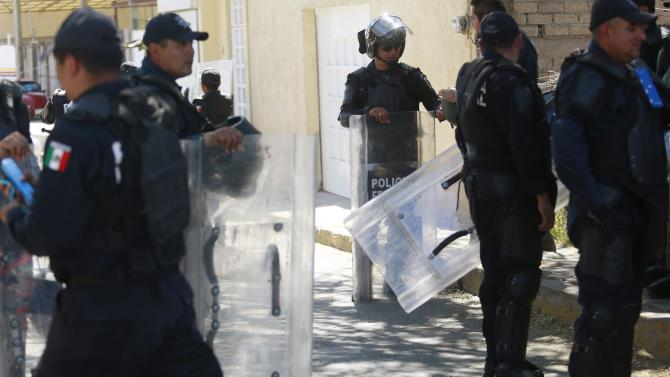 Federal police officers stand guard in the streets around the Attorney General's office in Chilpancingo, in the Mexican state of Guerrero