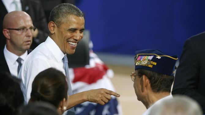 President Barack Obama greets veterans after he addressed U.S. and Philippine troops at Fort Bonifacio in Manila, the Philippines, Tuesday, April 29, 2014. Obama is wrapping up his four country eight day tour of Asia. (AP Photo/Charles Dharapak)