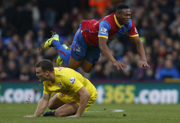 Crystal Palace's Kagisho Dikgacol, right, is tackled by Cardiff City's Ben Turner during their English Premier League soccer match at Selhurst Park, London, Saturday, Dec. 7, 2013