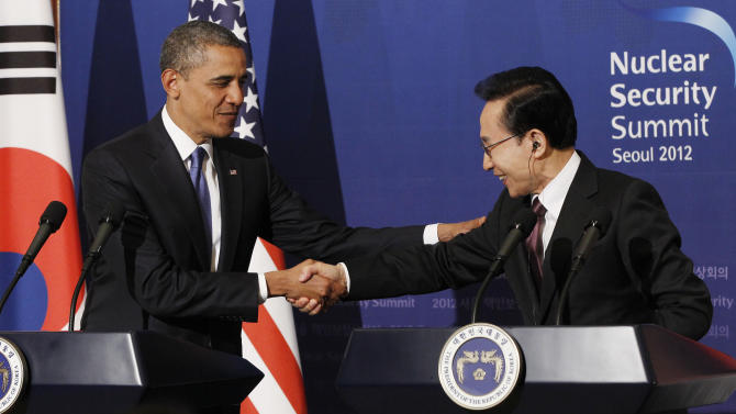 U.S. President Barack Obama shakes hands with South Korean President Lee Myung-bak during their joint news conference at the presidential Blue House in Seoul, South Korea, Sunday, March 25, 2012. (AP Photo/Pablo Martinez Monsivais)