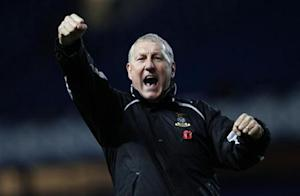 Inverness Caledonian Thistle manager Butcher celebrates after their Scottish League Cup soccer match over Rangers in Glasgow, Scotland