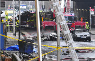 FILE In this Wednesday, Jan. 16, 2013 file photo, debris lies on the ground after a helicopter crashed into a construction crane on top of St George's Wharf tower building, in London. An official report on last week's helicopter crash in central London says the pilot was warned about bad weather before he started his ill-fated flight. Pilot Pete Barnes and one person on the ground died in the Jan. 16 crash in London's Vauxhall neighborhood. The Air Accidents Investigation Branch said Wednesday, Jan. 23, 2013, that Barnes' client had advised him not to start the flight because of foul weather. (AP Photo/Vince Pol, File)