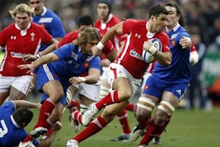 Wales' Mike Phillips runs during their Six Nations rugby match against France at the Stade de France in Saint-Denis near Paris