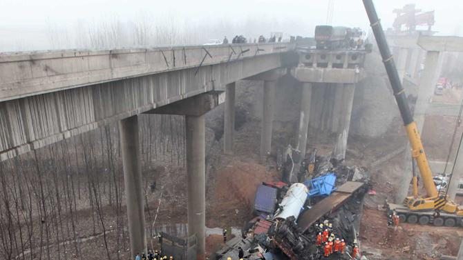 ALTERNATE CROP OF XIN801 - In this Feb. 1, 2013 photo provided by China's Xinhua News Agency, rescuers work at the accident site where an 80-meter (260 foot) section of an expressway bridge collapsed in Mianchi County, Sanmenxia, central China's Henan Province.   An elevated portion of highway in central China collapsed on Friday after a truck loaded with fireworks for Lunar New Year celebrations exploded, killing at least nine people and sending vehicles plummeting 30 meters (about 100 feet) to the ground. (AP Photo/Xinhua, Zhang Xiaoli) NO SALES