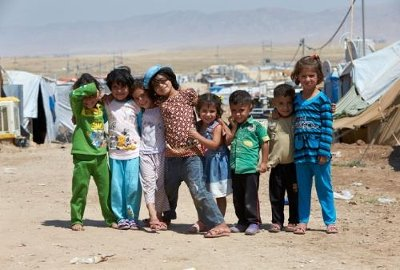 Syrian refugee children team up in the Domiz refugee camp, which is in the Kurdish part of Iraq. The living conditions in the camp are tough for the around 55,000 Syrian refugees who are staying there. Photo by Rob Holden.