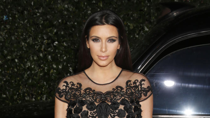 FILE - In this Feb. 13, 2013 file photo, Kim Kardashian attends the Topshop Topman LA Opening Party At Cecconi's in Los Angeles. Kardashian is among 11 celebrities and government officials whose private financial information appears to have been posted online by a site that began garnering attention on Monday, March 11, 2013.  (Photo by Todd Williamson/Invision for/AP, File)