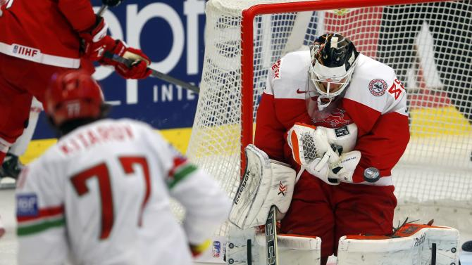 Denmark's goaltender Galbraith saves a shot of Kitarov of Belarus during their Ice Hockey World Championship game at the CEZ arena in Ostrava