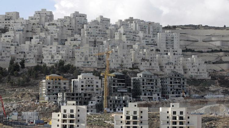 A picture shows under construction buildings at at Har Homa Israeli settlement near the West Bank city of Bethlehem, 23 January 2008