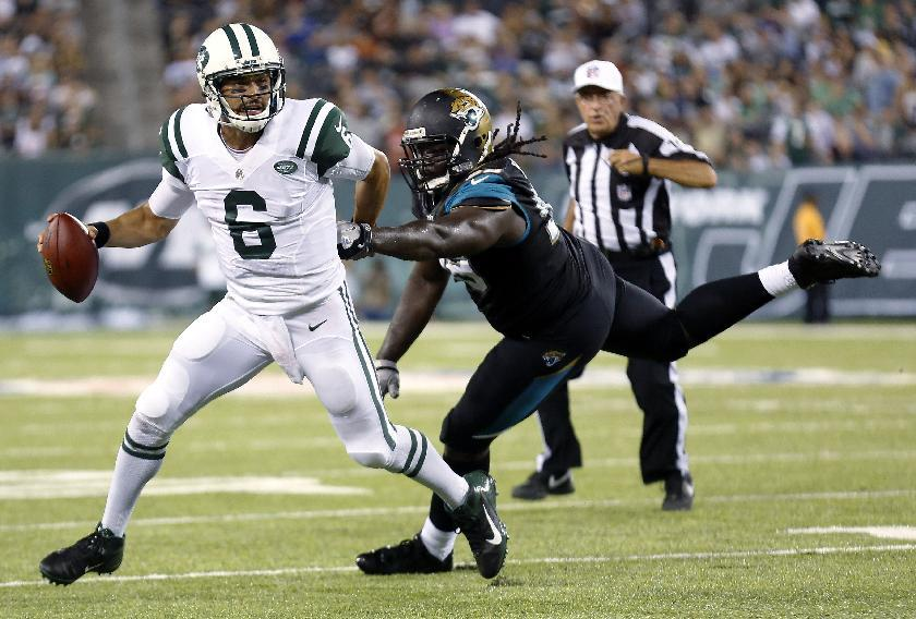 Sanchez up and down, Gabbert hurt as Jets top Jags