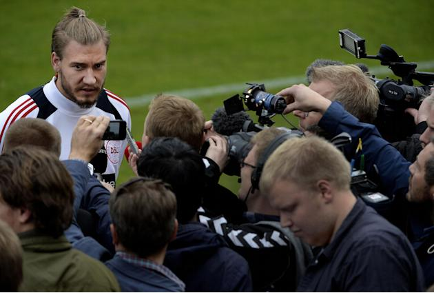 Nicklas Bendtner talks to the media before a training session with the Danish national soccer team, after a six-month absence following a conviction for drink-driving, at Helsingor Stadium, Denmark, M