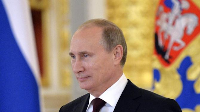 """FILE - In this June 27, 2014, file photo, Russian President Vladimir Putin attends a ceremony of presentation of credentials by foreign ambassadors in the Grand Kremlin Palace in Moscow. In a statement published on the Kremlin website on Friday, July 4, 2014, Putin said """"regardless of difficulties and disagreements"""" he hoped that Russia and the U.S. could """"successfully develop relations on pragmatic and equal grounds."""" Relations between Russia and the U.S. have deteriorated as the two countries have struggled to find common ground in Ukraine. (AP Photo/Yuri Kadobnov, Pool, File)"""
