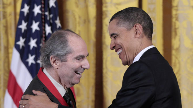 FILE - In this March 2, 2011, file photo, President Barack Obama, right, presents a National Humanities Medal to novelist Philip Roth during a ceremony in the East Room. Roth turned 80 on Tuesday, March 19, 2013 and he's in his hometown Newark, N.J., for the occasion, where several events are planned in his honor. (AP Photo/Pablo Martinez Monsivais, file)