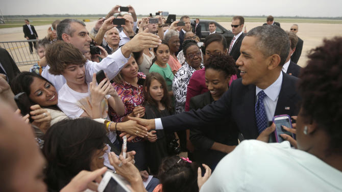 President Barack Obama greets guests on the tarmac upon his arrival on Air Force One at Austin-Bergstrom International Airport, Thursday, May 9, 2013 in Austin, Texas. (AP Photo/Pablo Martinez Monsivais)