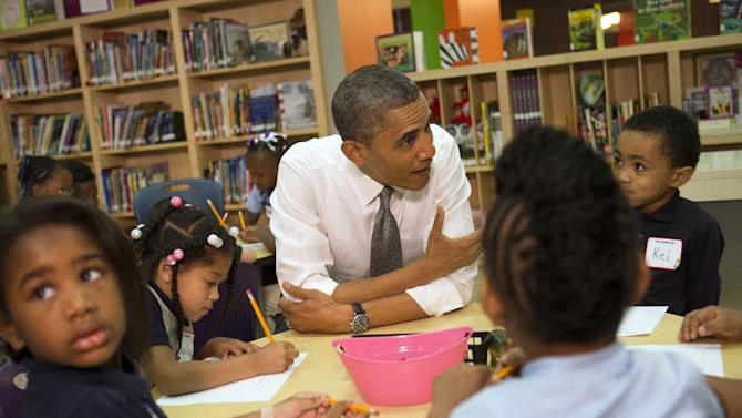 """President Barack Obama talks to a class of pre-Kindergarten school children at Moravia Park Elementary School in Baltimore, Md., Friday, May 17, 2013, during the his second """"Middle Class Jobs and Opportunity Tour"""". (AP Photo/Jacquelyn Martin)"""