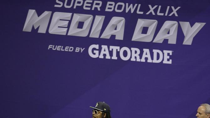 Seattle Seahawks' Marshawn Lynch leaves at the beginning of media day for NFL Super Bowl XLIX football game Tuesday, Jan. 27, 2015, in Phoenix. (AP Photo/Charlie Riedel)